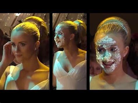 Katie (Sammy Winward) has her face shoved in her wedding