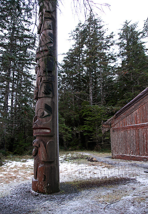 totem pole in front of Chief Son-i-Hat Whale House, Kasaan, Alaska