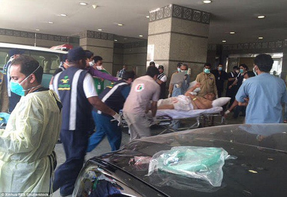 Health workers help the wounded near Saudi Arabia's holy Muslim city of Mecca after the stampede killed and injured hundreds of pilgrims