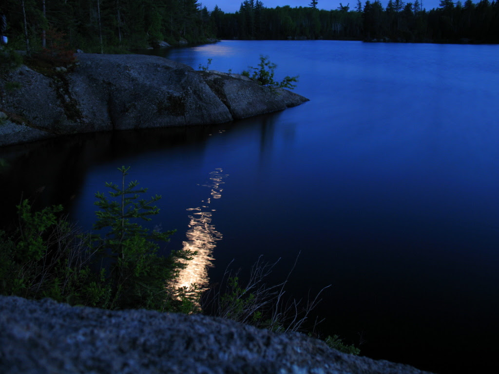 A nighttime photo of the moonlight dancing on the waters in the BWCA, Boundary Waters Canoe Area.