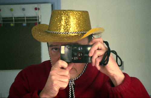 reflected self-portrait with Olympus AF-1 Twin camera and gold cowboy hat by pho-Tony