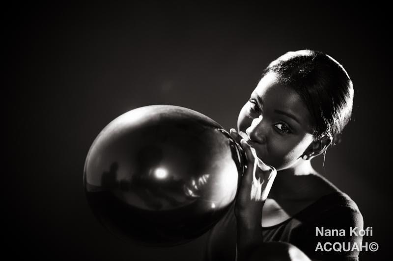 Ballerina blows a balloon
