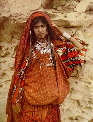 Libyan woman, 1925. |  All jewelry is silver. She is wearing a necklace of salhat-ornaments, also found in Egypt | National Geographic, 1925