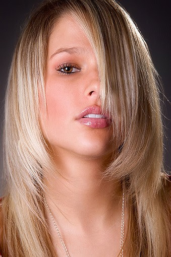 Picture of medium long women hairstyle with layers.jpg picture