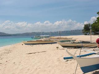 Bangkas on the beach at Club Paradise