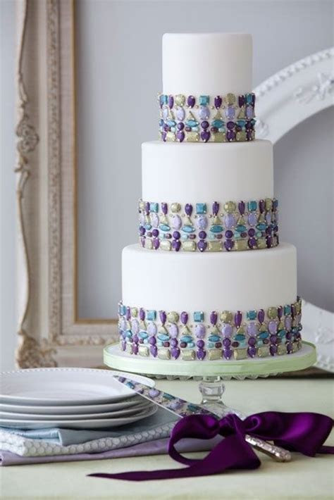 A Bejeweled turquoise, purple, and blue wedding cake