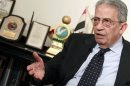 Opposition leader Amr Moussa, a former Arab League secretary-general and Egyptian foreign minister, talks to Reuters during an interview in Cairo