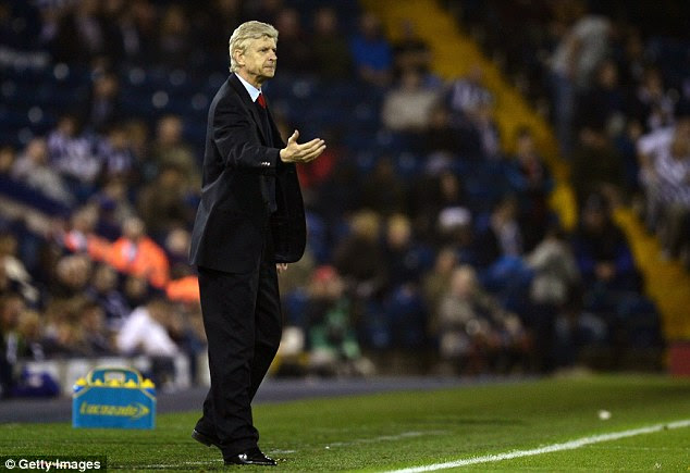 Form: Wenger endured a tough summer, but his side have the momentum early on in the season