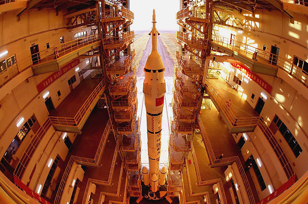 The rocket carrying Shenzhou VI, the PRC's last successful manned venture into space, stands in its assembly bay at a factory in Jiuquan, shortly before its October 12, 2005 launch.