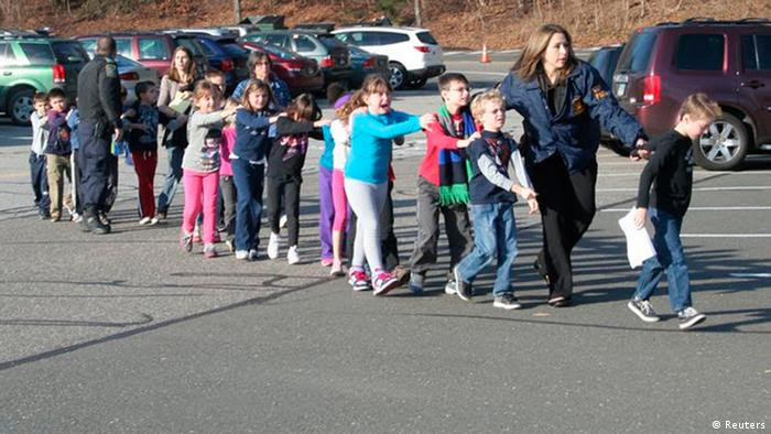 State police personnel lead children from the Sandy Hook Elementary School in this handout picture from the Newtown Bee, in Newtown, Connecticut, December 14, 2012. All public schools in Newtown, Connecticut, were placed in lockdown on Friday following a shooting at Sandy Hook Elementary School. REUTERS/Newtown Bee/Shannon Hicks/Handout (UNITED STATES - Tags: CRIME LAW) NO SALES. NO ARCHIVES. FOR EDITORIAL USE ONLY. NOT FOR SALE FOR MARKETING OR ADVERTISING CAMPAIGNS. THIS IMAGE HAS BEEN SUPPLIED BY A THIRD PARTY. IT IS DISTRIBUTED, EXACTLY AS RECEIVED BY REUTERS, AS A SERVICE TO CLIENTS
