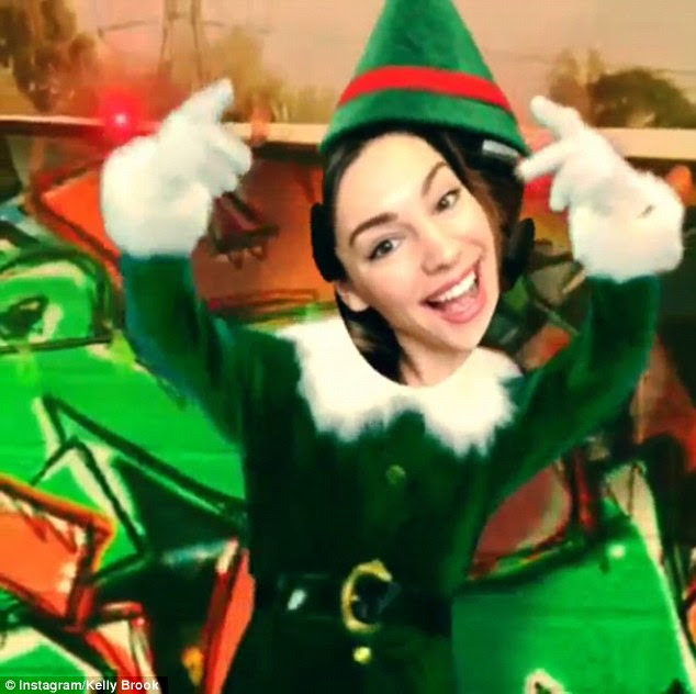 'Happy Holidays': Kelly Brook posted an animated Christmas card on her Instagram page on Saturday, starring herself as a dancing elf