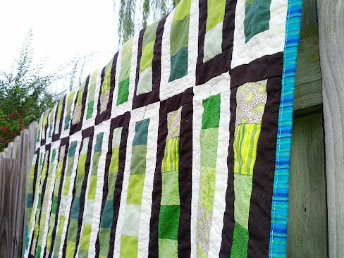 quilt on a fence