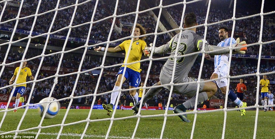 Argentina forward Ezequiel Lavezzi (right) puts the ball past Brazilian goalkeeper Alisson to open the scoring