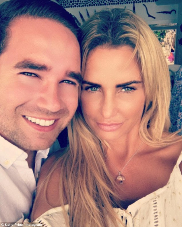 Happier than ever: On Tuesday, Katie shared this loved-up snap of herself and her man as she reassured her fans that all is well