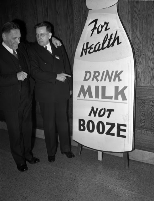 http://stuffaboutminneapolis.tumblr.com/post/140445100614/two-men-discussing-a-drink-milk-not-booze-sign