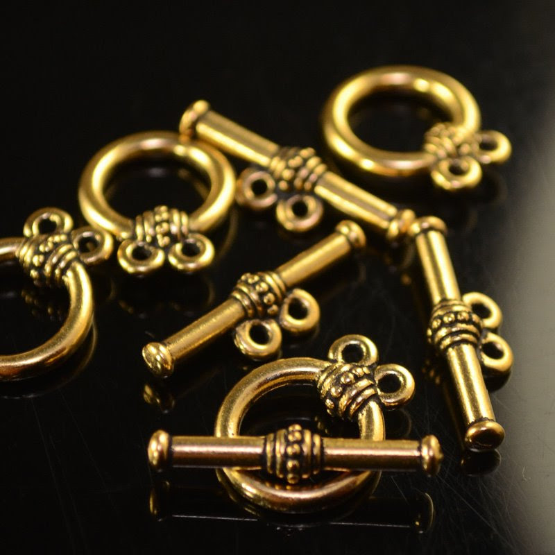 tc94-6082-26 Findings - Clasps - Toggle - 2 Strand Rope Wrap - Antique Gold (1)