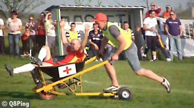 Motorised wheelbarrow used to stretcher off player