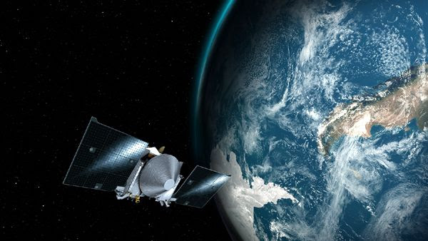 An artist's concept of NASA's OSIRIS-REx spacecraft flying past Earth on its way to asteroid Bennu...on September 22, 2017.