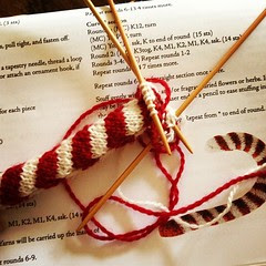 An almost finished candy cane ornament.