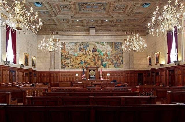 Mural over the judge's bench in the main courtroom in Miami's old federal courthouse.