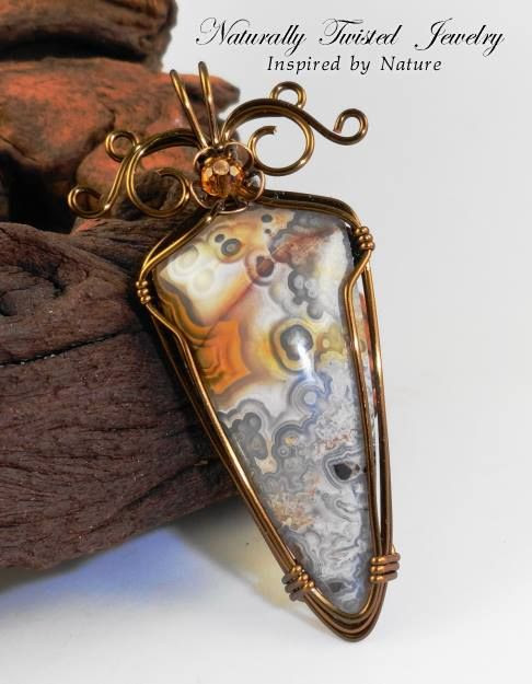 Crazy Lace Agate wrapped in Antique Bronze Parawire