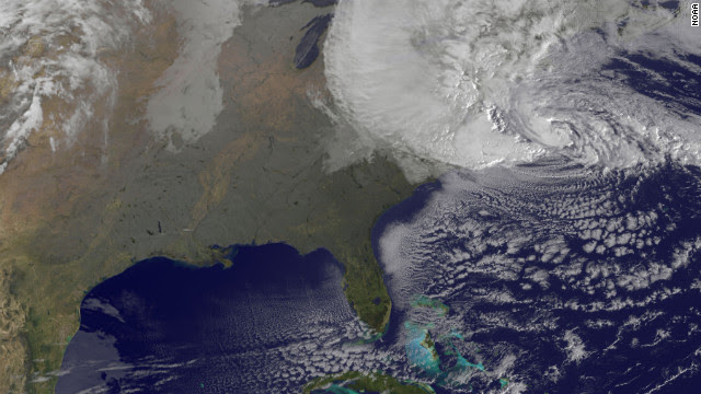 """A satellite image shows Hurricane Sandy at 8:25 a.m. ET Monday. Forecasters warned that Sandy was likely to collide with a cold front and spawn a """"superstorm"""" that could generate flash floods, snowstorms and massive power outages."""