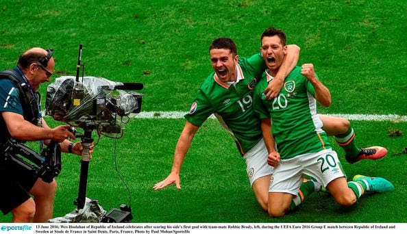 13 June 2016; Wes Hoolahan of Republic of Ireland celebrates after scoring his side's first goal with team-mate Robbie Brady, left, during the UEFA Euro 2016 Group E match between Republic of Ireland and Sweden at Stade de France in Saint Denis, Paris, France. Photo by Paul Mohan/Sportsfile