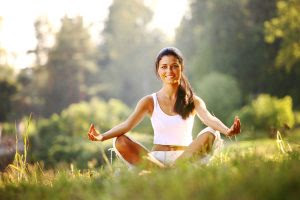bigstock-yoga-woman-on-green-grass-12517412