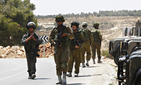 Israeli soldiers patrol near the West Bank city of Hebron