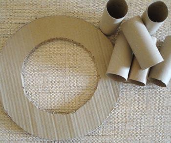 Material para confeccionar uma guirlanda de rolinhos de papel