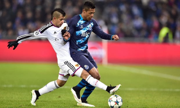 Basel's Derlis Gonzalez attempts to dispossess Porto defender Alex Sandro.