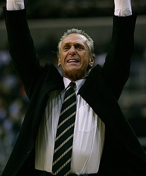 Pat Riley trying to get his players' attention.