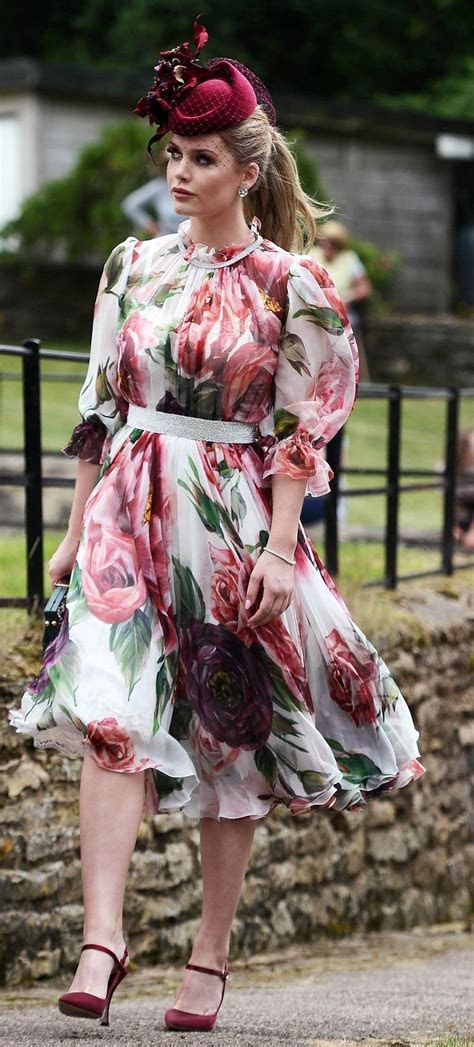 Meghan Markle Goes Floral & Coordinates with Prince Harry