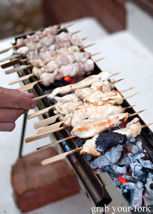 yakitori chicken breast skewers on an arrosticini charcoal grill at a stomachs eleven japanese dinner