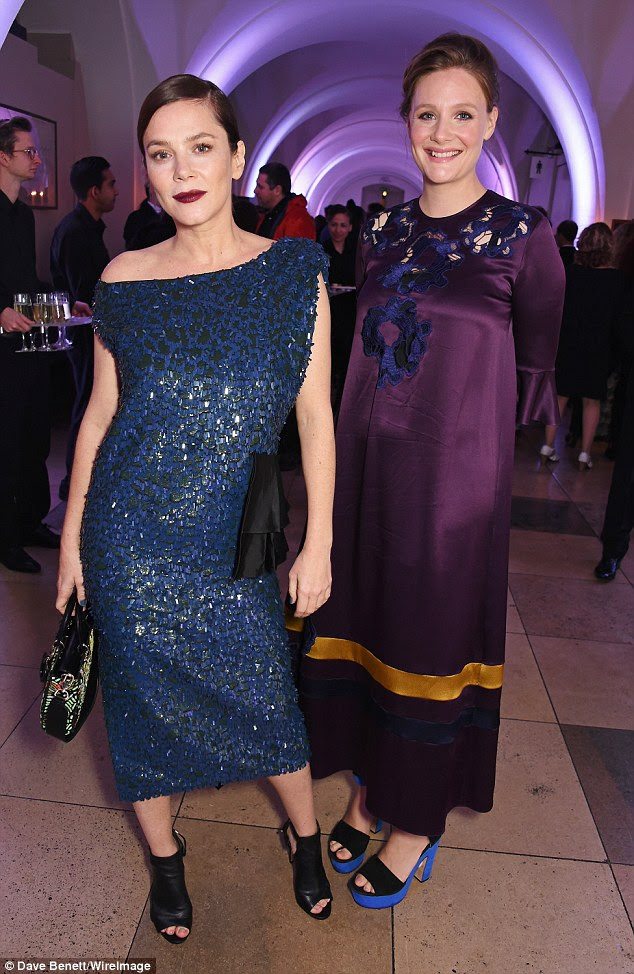 Eclectic:Romola Garai sported an unusual long sleeved purple gown with orange stripe and blue lace detail at the neck