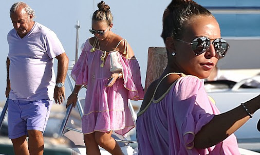 Chloe Green showcases her sun-kissed skin in stylish pink cover-up