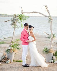 driftwood arbor rustic beach ceremony  celebrated