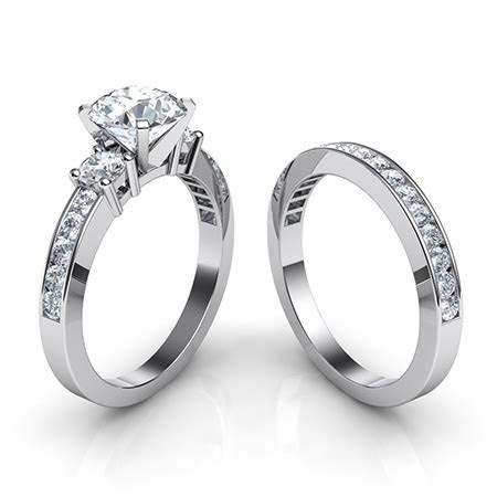 Trilogy Engagement Ring and Matching Wedding Band Bridal