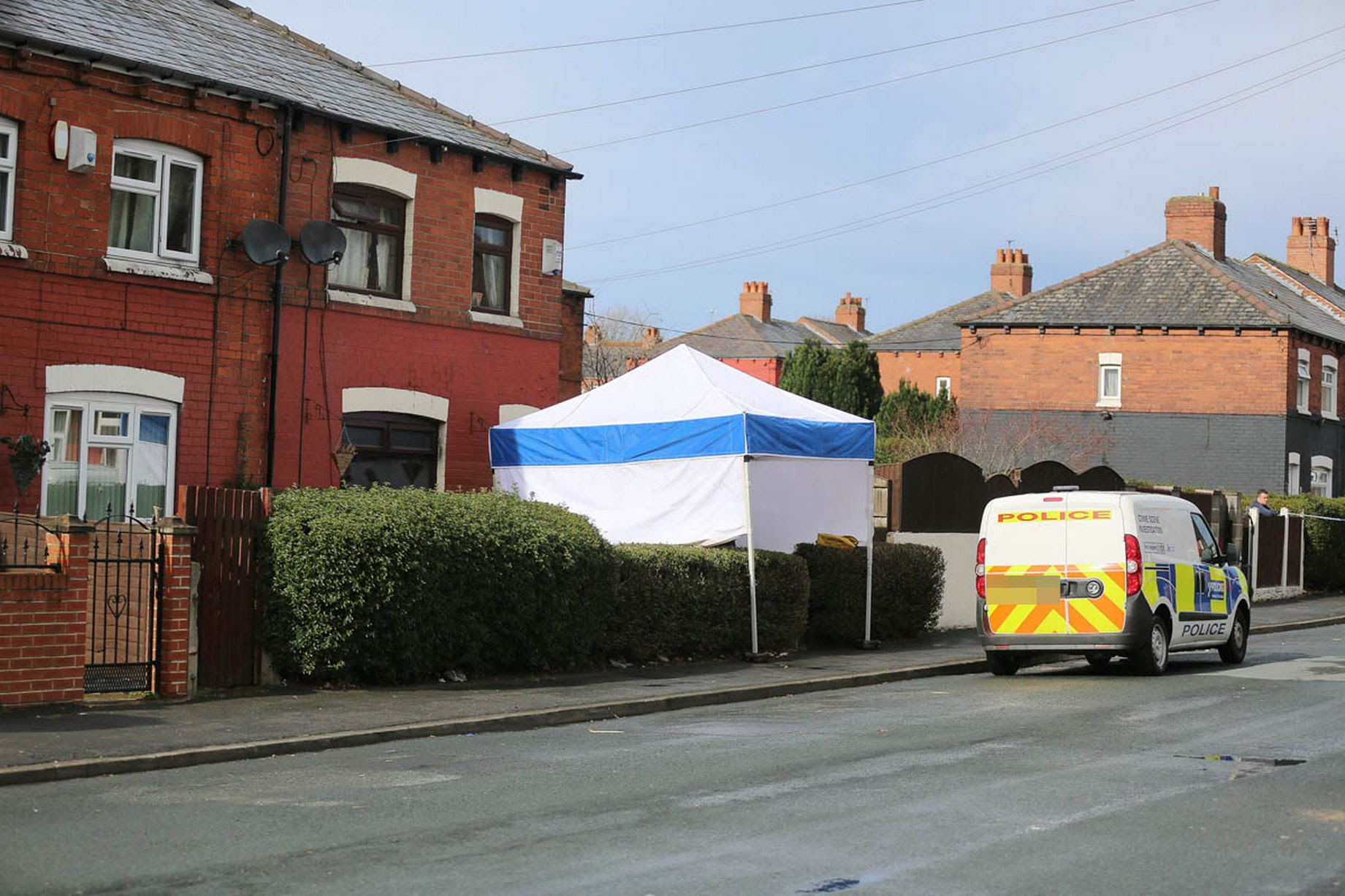 Police forensics and detectives at a house on East Park Street, Leeds, where three bodies have been found