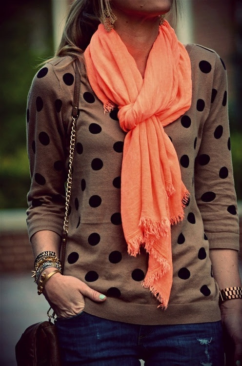 sweater with the bright, plain scarf.