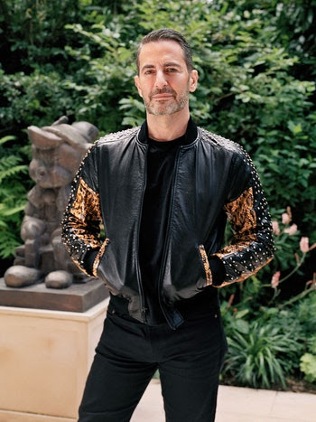 Marc Jacobs (pictured in his garden) worked with interior designers Paul Fortune, John Gachot, and Thad Hayes on his Greenwich Village townhouse.