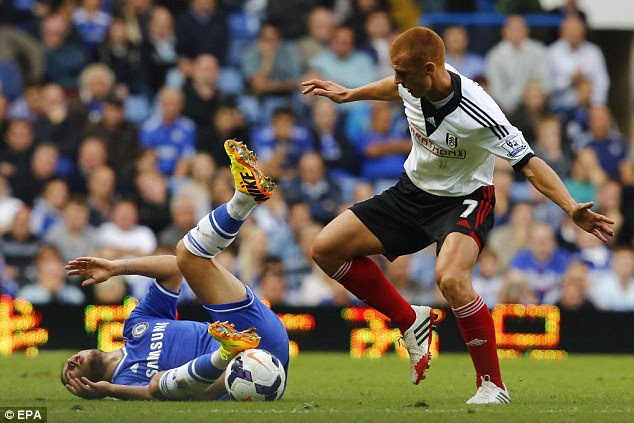 Flattened: Steve Sidwell leaves Eden Hazard on the floor after a challenge