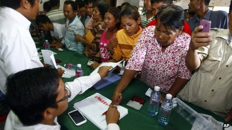 Supporters of the opposition Cambodian National Rescue Party gather to give their thumbprint as they complain that their names were not in the voting lists in 28 July election, during a public forum on the topic of the election of 28 July, at the party's office in Phnom Penh, Cambodia, 31 July 2013