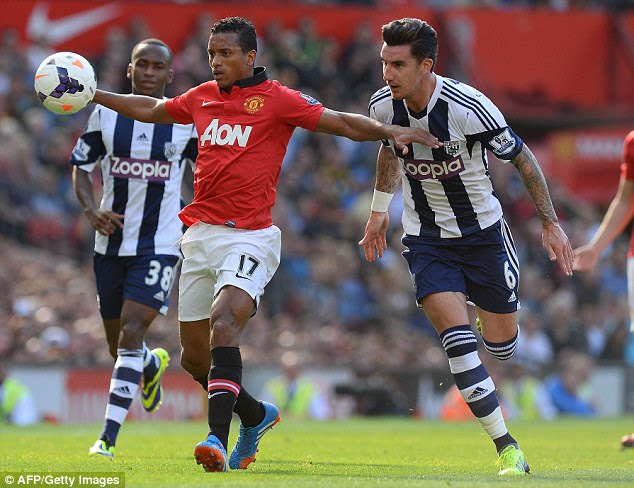 Tussle: United's Nani (left) attempts to hold off the challenge of West Brom defender Liam Ridgewell