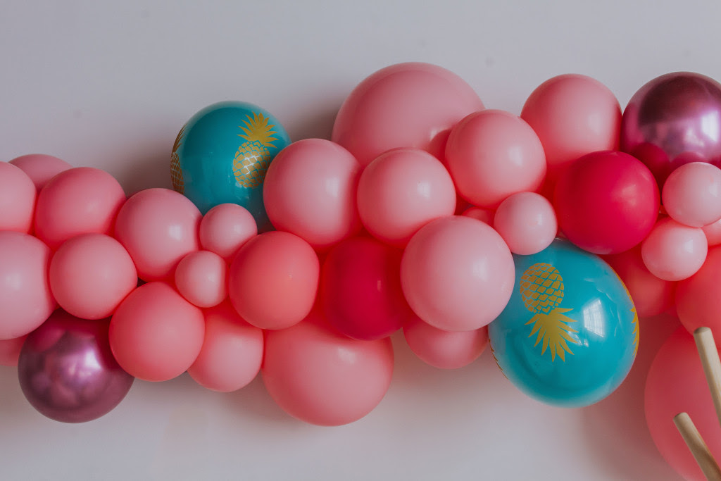 pink and turquoise balloons for a flamingo pineapple party