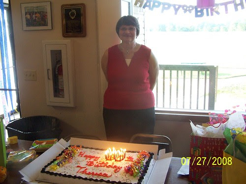 Mom with lit cake
