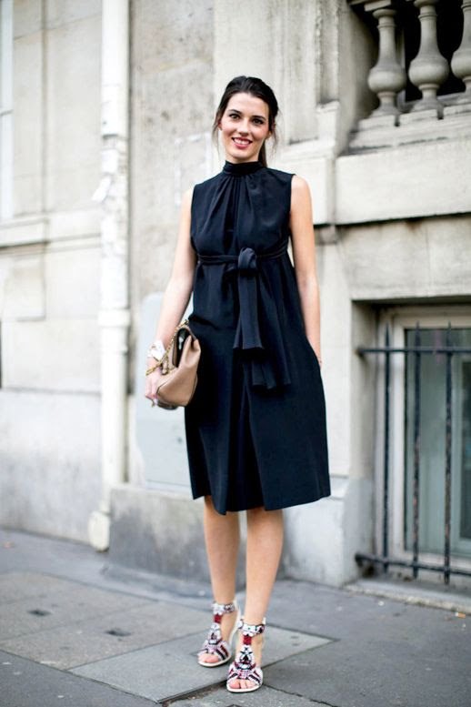 Le Fashion Blog Street Style Pfw Black Belted Dress With A High Neck Neutral Bag Embellished Sandals Via Popsugar