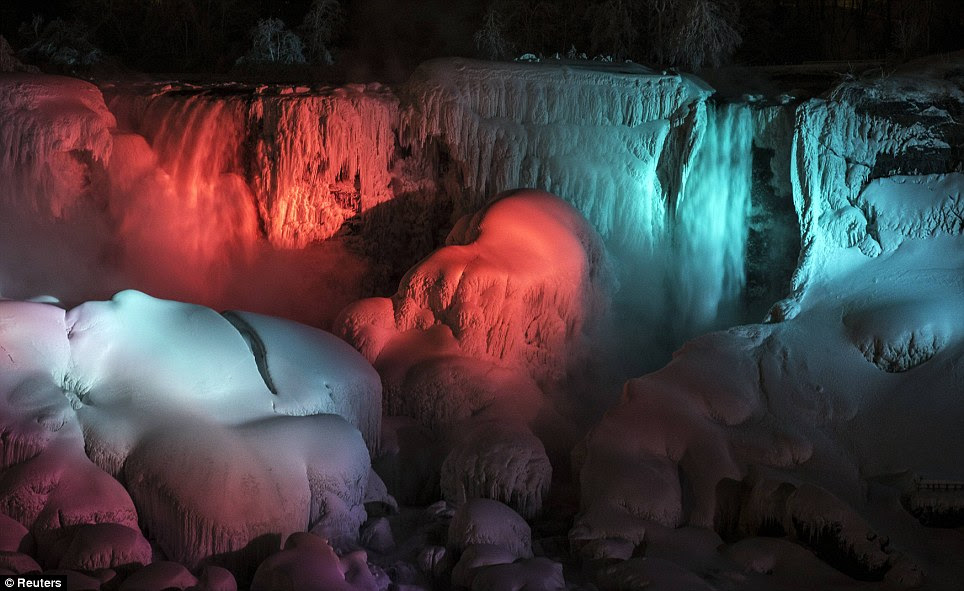 Gorgeous: Lights illuminate the frozen Falls as temperatures drop into single digits