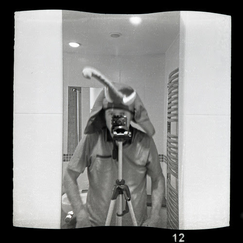 reflected self-portrait with IDAM Roc camera and elephant hat by pho-Tony
