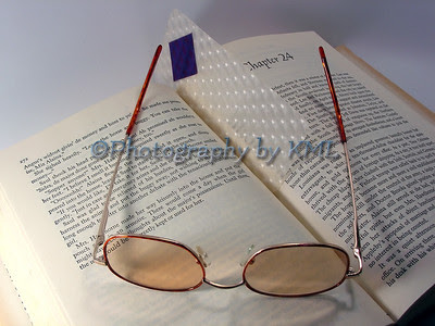 reading glasses with an open book